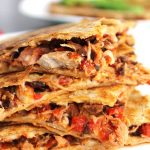 Chicken Mediterranean Quesadillas | Shredded chicken breast, roasted red peppers, kalamata olives, a touch of red onion, & meltedparmesanbetween two tortillas. Make the filling in big batches for a super easy freezer meal! Read on for my Paleo, gluten-free, & dairy free suggestions.. | thenourishedfamily.com
