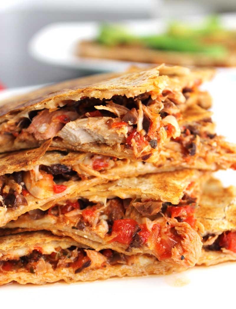Chicken Mediterranean Quesadillas | Shredded chicken breast, roasted red peppers, kalamata olives, a touch of red onion, & melted parmesan between two tortillas. Make the filling in big batches for a super easy freezer meal! Read on for my Paleo, gluten-free, & dairy free suggestions.. | thenourishedfamily.com