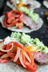 Easy Grilled Steak Fajitas Recipe | This a simple recipe that our family loves all year round. Easily made Paleo with grain free tortillas & dairy-free byomitting the cheese. | thenourishedfamily.com