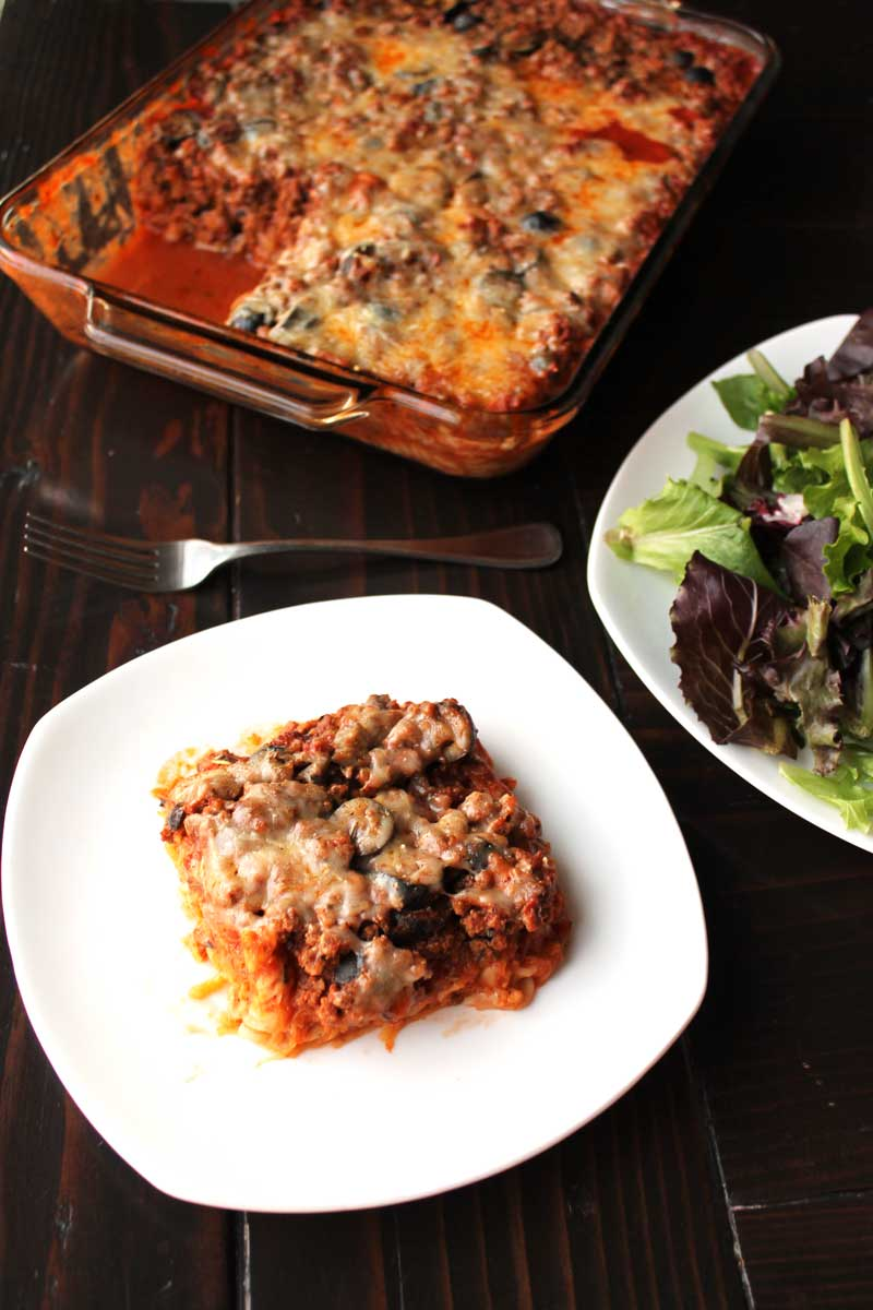 Healthy Baked Mostaccioli {Gluten-free} | This Healthy Baked Mostaccioli is our toddler's #1 favorite meal -- she LOVES it! A gluten free (Paleo option) meal with a hidden layer of spaghetti squash, ground beef, & savory sauce are all a part of this easy Italian themed family casserole.  | thenourishedfamily.com