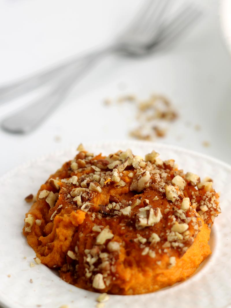 Healthy Sweet Potato Casserole Recipe {Paleo} | A healthy Thanksgiving tradition that is easy to make, naturally sweetened, & Paleo | thenourishedfamily.com