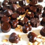 Dark Chocolate Peanut Butter Candy | Dark Chocolate Peanut Butter Candies are a nutrient dense treat that have a rich, mouth watering chocolate flavor with a smooth nutty taste in a satisfying coconut oil base. These candies are served cold right out of the freezer or chilled from the fridge. | thenourishedfamily.com