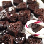 Dark Chocolate Peppermint Candies | They melt in your mouth with an intensely REAL chocolate taste. The coconut oil makes them very satisfying with crushed organic candy canes for texture and a touch of raw honey to satisfy your sweet tooth. | thenourishedfamily.com